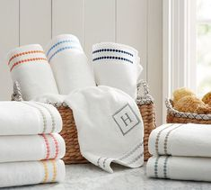 An embroidered string of pearls borrowed from our Pearl Embroidered Bedding punctuates our cotton towels. Monogrammed Hand Towels, Monogram Towels, Personalized Towels, Pottery Barn Bath, Pottery Barn Kids, Blue Towels, Pool Towels, Cotton Towels, Embroidered Bedding
