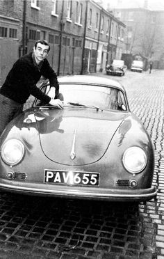 Sean Connery checks on his wipers shortly after signing on as James Bond. Wavel Mews, Hampstead, London. December 1961
