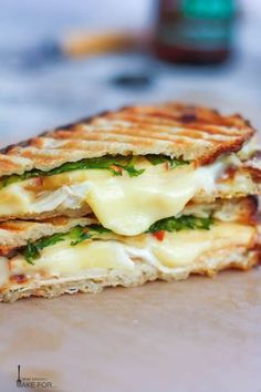This simple recipe will probably be one of the best sandwich meals you ve ever had This panini combines chicken brie cheese and apple slices with a drizzle of honey on your choice of bread An easy weeknight meal or a healthy summer lunch treat Brie Sandwich, Panini Sandwiches, Grilled Sandwich, Sandwich Recipes, Healthy Panini Recipes, Vegetarian Sandwiches, Paninis, Easy Meals, Weeknight Meals