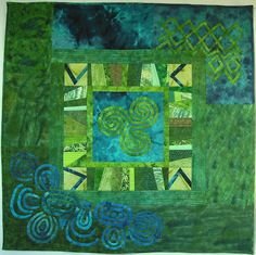 Triple spiral quilt by Gyöngyi Váradi.  Blues and greens.