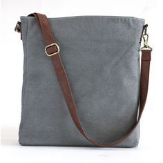 """Waxed Canvas Ash Sling Crossbody 14"""" x 12"""" x 2.5"""" Printed on recycled waxed canvas with eco-friendly pigment inks. You know all those times you need a free hand, or two? This is the bag for it. Featur"""