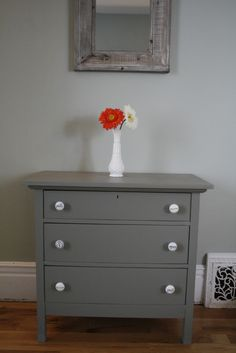 I'm planning on painting mom's old furniture grey :)