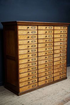 A forty two drawer museum or collectors cabinet. Beautiful construction in birds eye maple and mahogany, the drawers having turned and ebonised handles with bronze card holders. English, Manchester, Circa 1860