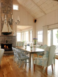 Tour Sarah's Summer House | HGTV like he long skinny table and the yellowish pickled ceiling WOULD LIKE THIS CEILING IN BEDROOM, WITH PAINTED WHITE BEAMS, OR STAINED BEAMS......