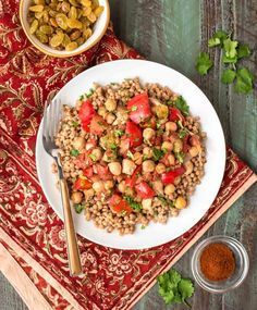 Slow Cooker Moroccan Chicken recipe — your crockpot does all the work! An easy recipe for busy days. Made with warm spices, chickpeas, juicy chicken, golden raisins, and fresh veggies. This recipe is healthy, super cheap, and if you use rice or quinoa, it's gluten free! @wellplated