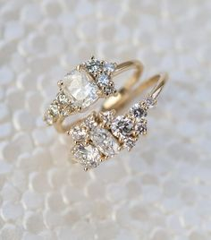 These cleverly-designed Custom Cluster Engagement Rings are made entirely of heirloom diamonds, hand-arranged to find the most pleasing composition.