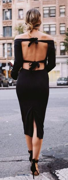 Black off the shoulder midi dress.