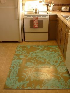 DIY rug - painted on top of a kids' foam mat.  really nice idea for the kitchen
