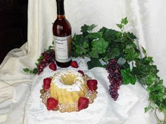 ♥  One of the beautiful cakes our Top Fan will get to choose from.    Strawberry Wine Pound Cake ♥  Vanilla Pound Cake infused with Mattaponi Winery Strawberry Wine    Like them on FB  http://www.facebook.com/heavensgatecatering      and if you can't wait  http://74.220.215.82/~heavenu0/shoponline/index.php/virginia-wine-pound-cakes/strawberry-wine-pound-cake.html