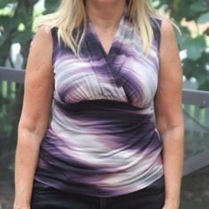 JKLA purple and white sleeveless blouse Polyester and spandex, wrap-around top, purple and white with black stripes. Size S. JKLA California Tops Blouses