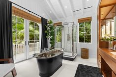 Inside golfing Legend Greg Norman's Tropical Paradise in Jupiter Island, Florida. Designed by Greg's wife, designer Kirsten Norman, the rooms take their inspiration from luxury yacht interiors. Drummonds' Tyne bath and Thrurso freestanding shower fitted in perfectly with the luxury interiors brief. @kirstenpnorman @shark_gregnorman Contemporary Bathrooms, Modern Bathroom, Bathroom Suppliers, Luxury Yacht Interior, Cast Iron Bath, Roll Top Bath, Bathroom Goals, Wet Rooms, Traditional Bathroom