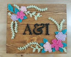 Flowers with initials constructed out of nails and thread. The size of this listing is 25 x 30 cm, and is ready to hang. Makes a lovely Mothers day gift. You can customize the following (just mention what you want in the notes when checking out): 2- Letters or Name 3- Color of thread