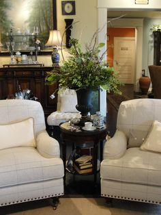 love dark wood against white with greenery and blue and white china--classic