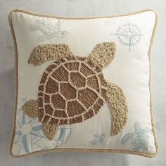 Go full coastal. Our embroidered sea turtle pillow was inspired by vintage ocean imagery of natural sea life and is accented with subtle script and line-drawn monochromatic turtle companions.