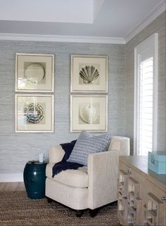 tray ceiling gray grasscloth wallpaper sepia toned seashell prints framed silver leaf frames peacock blue garden stool ivory chair cobalt blue throw oak