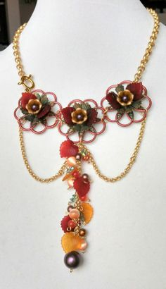 Funky, colorful, floral fun from Marcia Tuzzolino of Aurora Designs.  Festoon necklace, many of the metal components and beads came from B'sue Boutiques.  Marcia is also on the B'sue Boutiques Design Team.