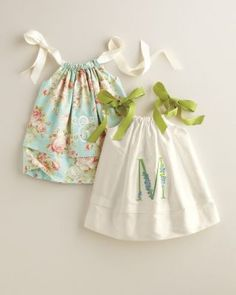 is there anything cuter?  I can just see my babe dipping her toes in the sand in this little number.