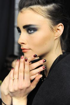 Not only do we love the two toned burgundy nail trned, we are lusting over this model's smokey eyes at the Nicole Miller show! #NYFW