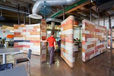 AECCafe.com - ArchShowcase - iProspect – Fort Worth in TX by VLK Architects  Pivoting wall made from salvaged barn wood; opens Commons to open office space
