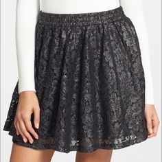 """Frenchi Foil Lace Skater Skirt Shimmering metallic lace makes for a dazzling twist on the skater-skirt trend! This skirt is brand new with tags and has never been worn. I bought it at Nordstrom and never wore it.  - 15"""" length (size Medium) - Lined - 65% cotton, 35% nylon Frenchi Skirts Circle & Skater"""
