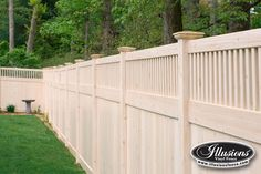 V3701-6 6' high Tongue and Groove Vinyl Privacy fence with Framed Victorian Top and New England Post Caps in Grand Illusions Vinyl Woodbond Eastern White Cedar Wood grain (W105). Find a fence that matches your house perfectly with Grand Illusions 35 different colors and 5 different wood grains.