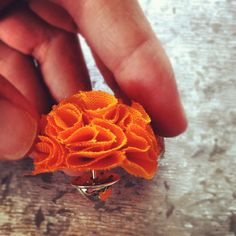 This stunning Mini Garden Pinks Brooch is a warm, orange colour - the perfect, must-have accessory for fall!    The flower is made of sunshine and using cotton fabric.    It has a pin on the back making it perfect and ready to wear on an outfit that needs that extra something.    The brooch is really cute and turns heads whenever worn.    Orange MINI Garden Pinks Brooch by TheGentleFlower on Etsy