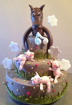 Lulu's birthday cake.The wolf & the little three pigs