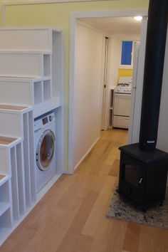 Inside this tiny house you'll find a wood stove, washer/dryer combo, two fold down tables, and a utility closet. Storage stairs lead to the main bedroom loft.