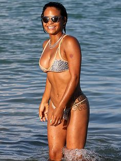 Christina Milian flaunted her perfectly bronzed beach bod in a leopard print bikini, topped off with trendy sunnies!