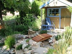 Ornamental grasses and a few shrubs give life to the stones used in this water feature.