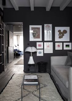 living room with grey walls in Lyon apartment by Maison Hand