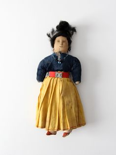 A vintage Native American doll. A Navajo doll with a painted cloth face. Cotton and velvet like clothing with delicate beaded jewelry. - Native American doll - painted cloth face - beading CONDITION I