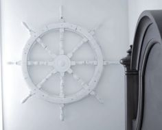 Chic Bedrooms -16 Nautical Design Ideas  Another great nautical design idea. Using Ship Wheels. This particular Ship Wheel was a thrift store find, painted white. To me ship wheels speak of voyages at sea and new discoveries.