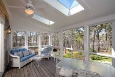 With a hardwood floor and walls of windows, this sunny porch room is a cheerful place to lounge and star gaze on clear nights.