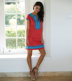 Kara Dress Red - Style Reference 17115 With beautifully contrasting vibrant colours, our Kara Dress by designer brand Sulu, is a real standout piece! Red patterned cotton is complemented by heavy blue embroidery inset with tiny-mirrored discs. • Short capped sleeves•Rounded neckline with deep v cut out•Midweight fabric with floral pattern• Intricate embroidered design in varying shades of red and blue Please note that the fabric of this dress is super lightweight cotton.