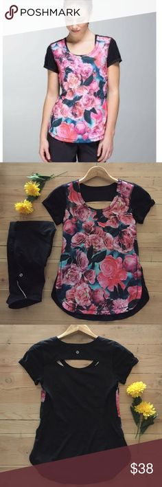 """  Lululemon """"Lightened Up"""" Secret Garden Top  Rare Lululemon """"Lightened Up"""" Secret Garden workout top.  Super light with capped sleeves high/low hem.  Roses on the front and black on the open back.  So pretty - it can be worn anywhere.  No size tag but fits like a 2.  Check measurements.  Bust is 30"""" and length is 24"""" in the front and 25"""" in the back.  In excellent condition. lululemon athletica Tops"""