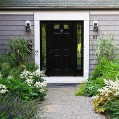 garden, black door, pea gravel