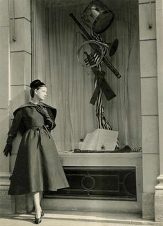 1952. Model reading about Balenciaga under window sculpture by Janine Janet, circa 1952. The Balenciaga Boutique, 10 Avenue George V. Paris. The Boutique opened in 1948 at 10 Avenue George V in the eighth arrondissement. This location had several...