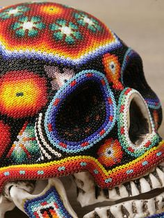 Beautiful Macabre Beaded Human Skulls by Mexican Huichol Artists