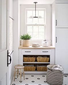 Laundry room heaven - white with amazing black and white patterned tile