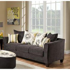Sink into the plush cushions of this gunmetal microfiber sofa by Sofa Trendz Ellyse.