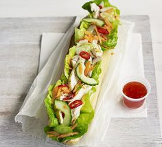 Stuff your sandwich with chicken, carrot, cucumber, spring onion and sweet chilli dressing for Asian zing