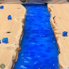 Learn how to make a DIY live edge river rock epoxy table that glows in the dark. Epoxy Resin Table, Diy Epoxy, Epoxy Countertop, Countertops, Glow Table, Dark Table, Live Edge Table, The Darkest, River