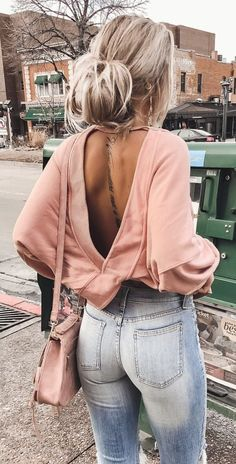 #spring #outfits woman in pink backless long-sleeved top. Pic by @kelsrfloyd