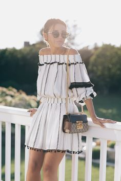 IN THE HAMPTONS - Lovely Pepa by Alexandra. White and black off the shoulder mini dress+black wedges+shoulder bag+sunglasses. Summer evening outfit 2016