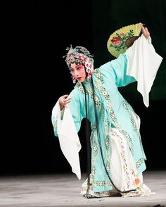 """This is a type of female character in Peking Opera called a 青衣 (qīng yī, """"qing colored costume"""") because they usually wear costumes of this interesting color."""