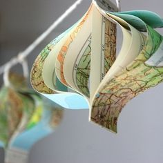 Things you can make with old maps. DIY ideas for old maps. Creative ways to use old maps in crafts and art. Bon Voyage Party, Map Crafts, Travel Crafts, Christmas Crafts, Christmas Ornaments, Christmas Paper, Christmas Decorations, Christmas Tree, Holiday Decor