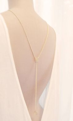 Elegant back necklace with camellias by Hedgehog Project