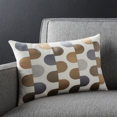 Embroidered in a palette of silky metallics, solid domes stagger in modernist array on solid white cotton. Pillow reverses to solid white. Our decorative pillows include your choice of a plush feather-down or lofty down-alternative insert at no extra cost.<br /><br /><NEWTAG/><ul><li>100% cotton with 100% rayon embroidery</li><li>On-seam zipper</li><li>Knife-edge tailoring</li><li>Machine wash cold on gentle, dry flat; cool iron as needed</li><li>Down-alternative insert: 100% polyester fill…