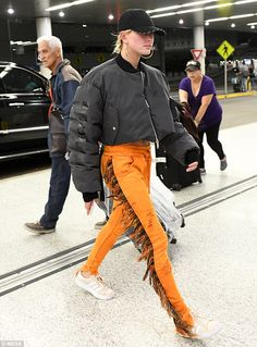 Interesting: Hailey later showed off her toned legs in a pair of quirky fringed orange jog...